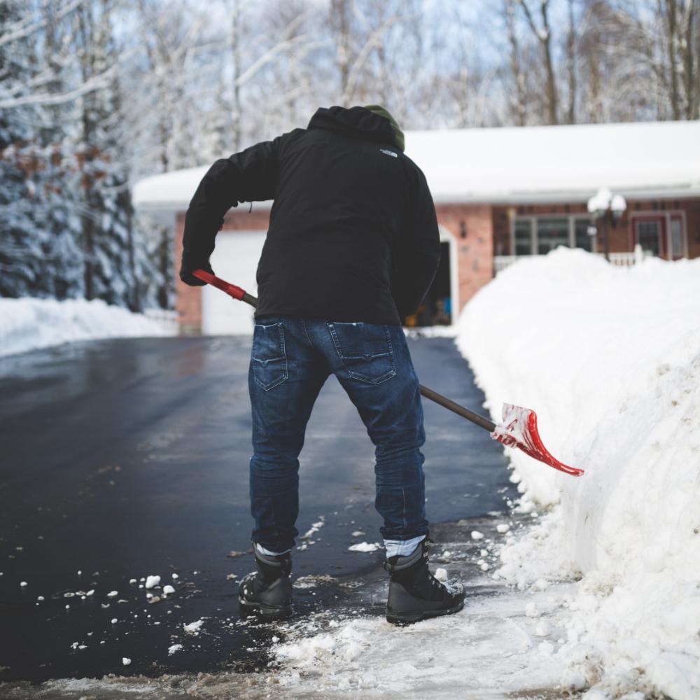Man Shoveling Driveway